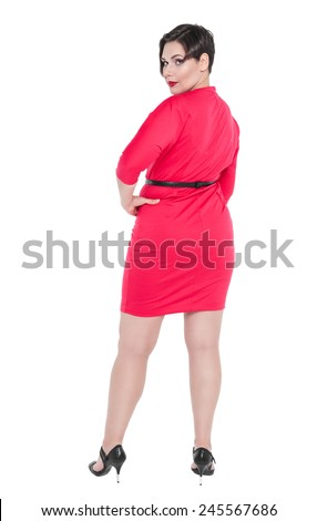 Beautiful plus size woman in red dress posing isolated  - stock photo