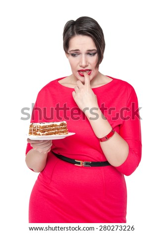 Beautiful plus size woman temptating with cake isolated - stock photo