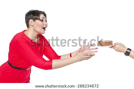 Beautiful plus size woman temptating with cake isolated over white - stock photo