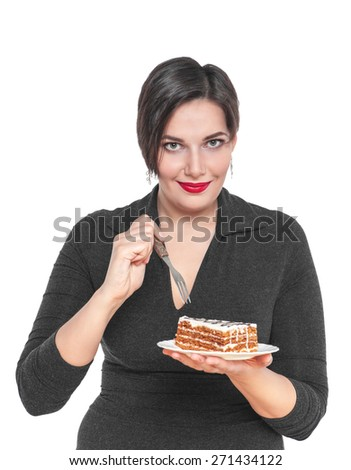 Beautiful plus size woman with cake isolated on white background - stock photo