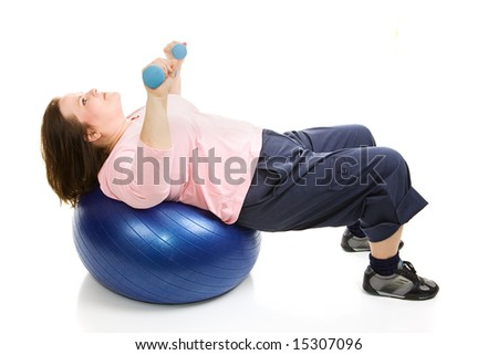 Beautiful plus sized model working out with free weights and a pilates ball.  Isolated on white. - stock photo