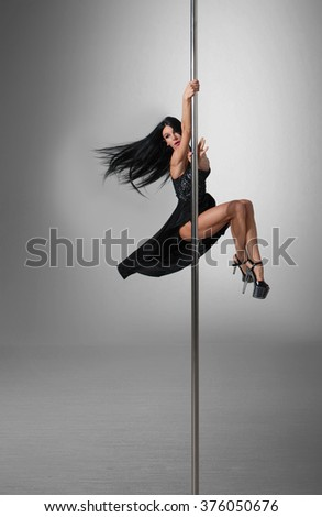 beautiful pole dancer weared dress making trick