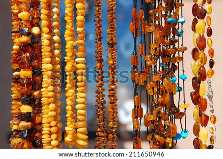 beautiful polish amber necklaces hanging at exhibition - stock photo