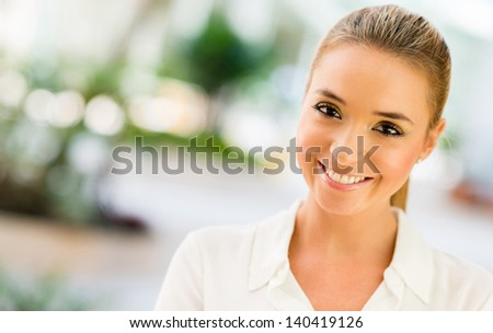Beautiful portrait of a casual woman smiling - stock photo