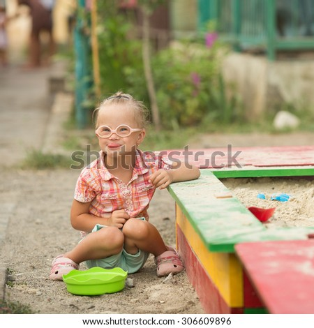 beautiful portrait of a girl with Down syndrome - stock photo