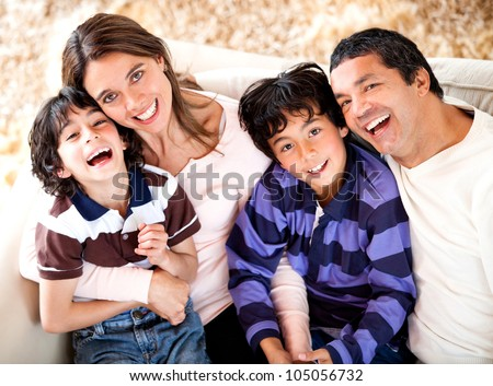 Beautiful portrait of a Latin family smiling - stock photo