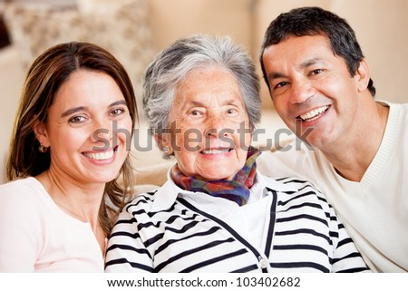 Beautiful portrait of a mother, son and daughter-in-law smiling - stock photo