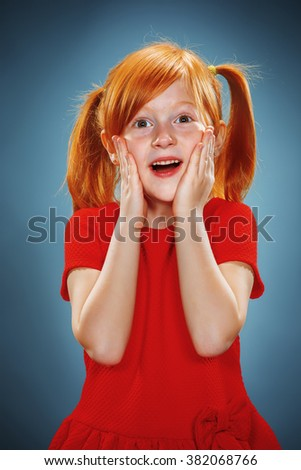 Beautiful portrait of a surprised little girl  - stock photo