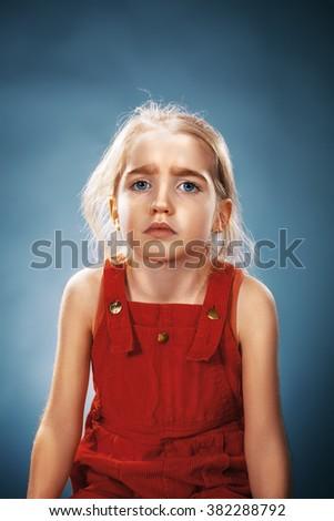 Beautiful portrait of a thoughtful little girl  - stock photo