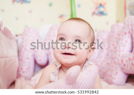 Beautiful portrait of a young child in pink colors