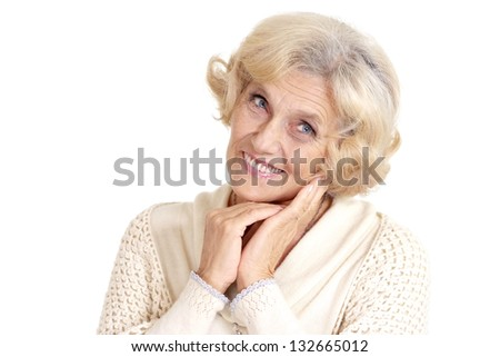 beautiful portrait of an elderly woman over a light background