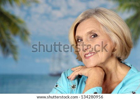 beautiful portrait of an older woman on vacation in the summer - stock photo