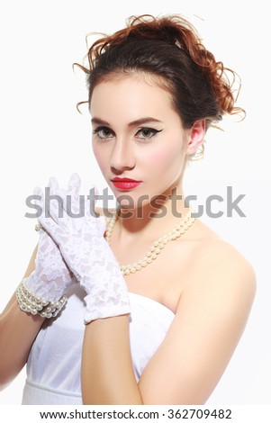 Beautiful portrait of sensual european young woman model with glamour red lips make-up, eye arrow makeup, purity skin. Retro beauty style - stock photo