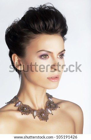 Beautiful portrait of sexy young haughty woman with precious necklace closeup. Serene. Studio shot - stock photo