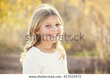 Beautiful Portrait of smiling little girl outdoors - stock photo