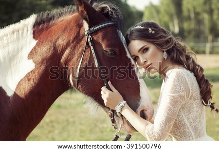 Beautiful Portrait Of Woman With Horse - stock photo