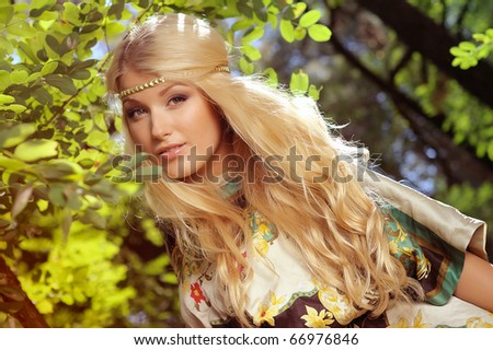 Beautiful portrait sexy blonde woman in forest - stock photo