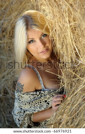 Beautiful portrait sexy young woman in the hay