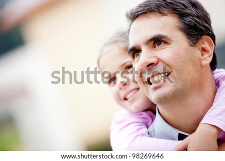 BEautiful portrit of a father and daughter smiling - stock photo