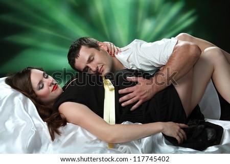 beautiful pregnant woman and man in studio - stock photo