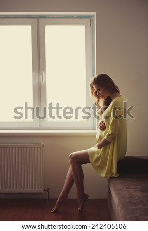 beautiful pregnant woman at home portrait - stock photo