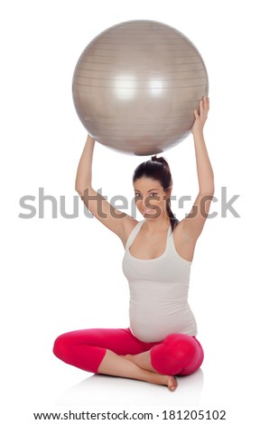 Beautiful pregnant woman doing exercise isolated on white background