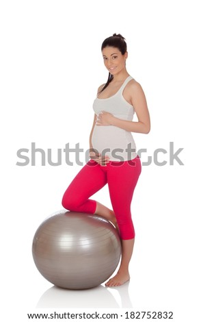 Beautiful pregnant woman doing exercise isolated on white background - stock photo