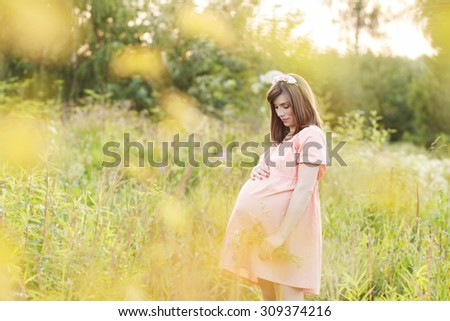 Beautiful pregnant woman feeling lovely and Relax in the park  - stock photo