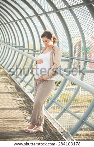 beautiful pregnant woman in a tunel - stock photo