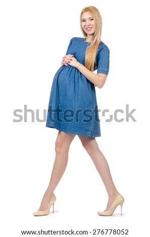 Beautiful pregnant woman in blue dress isolated on white - stock photo