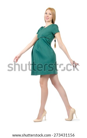 Beautiful pregnant woman in green dress isolated on white - stock photo
