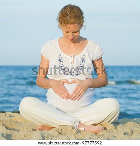 beautiful pregnant woman on a beach - stock photo