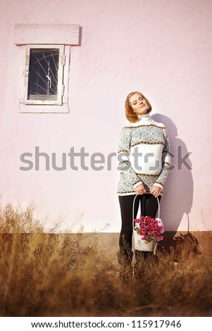 Beautiful pregnant woman posing outdoors in the park. Early warm autumn. - stock photo