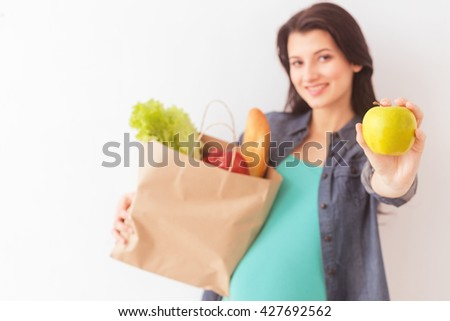 Beautiful pregnant woman prefers healthy eating - stock photo
