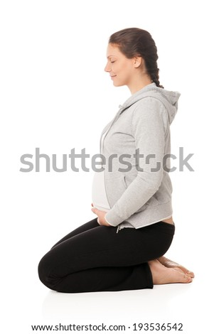 Beautiful pregnant woman smiling and doing exercises isolated