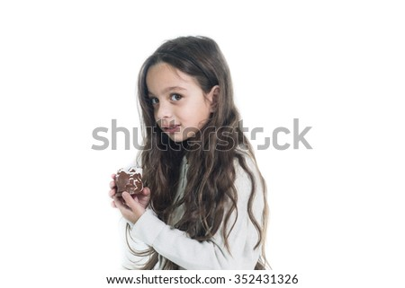 Beautiful preschool girl hold a chocolate-Covered Marshmallow Waferwhite, isolated - stock photo