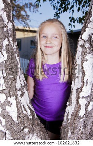 Beautiful pretty little girl with long blonde hair - stock photo