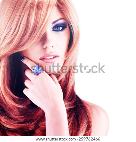 Beautiful pretty woman with long red hairs. Portrait  of young fashion model with blue eye makeup isolated on white background - stock photo