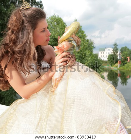 beautiful princess in wedding gown says good-bye to childhood - stock photo