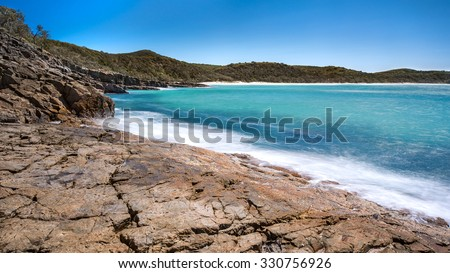 Beautiful Pristine Paradise Landscape With a Rocky Shoreline and Overlooking Alexandria Bay During a Tropical Sunny Day, Noosa National Park, Noosa Heads, Sunshine Coast, Queensland, Australia - stock photo