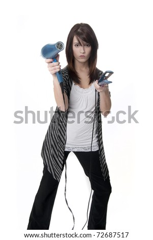 Beautiful professional hair stylist holding blow dryer and straightener - stock photo
