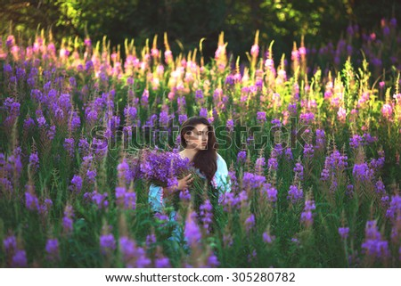 Beautiful provence woman relaxing in lavender field watching on sunset holding . Series. alluring girl with purple lavender. б�?�?не�?ка lady in blossom field . Ukraine -  л�?в�?в - stock photo