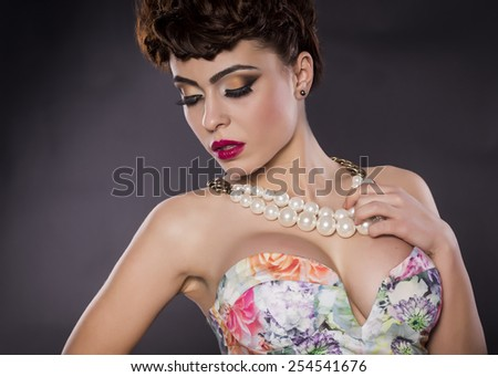 Beautiful provocative sensual woman posing in a studio - stock photo