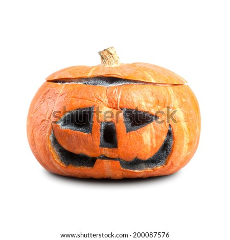 Beautiful pumpkin with a carved face for the holiday. On white background, isolated. Hallowen pumpkin. - stock photo