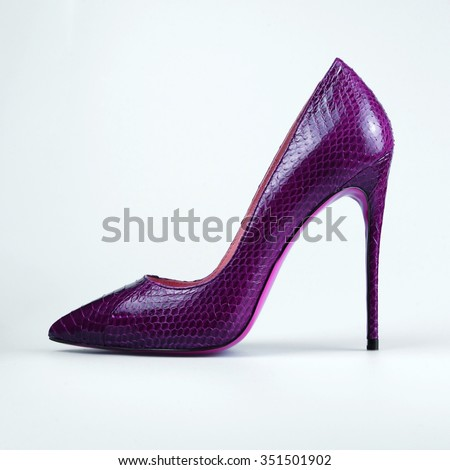 Beautiful purple classic women shoes isolated on white background