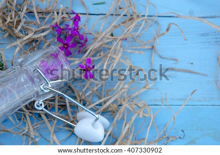 Beautiful purple flowers. Still Life . Bouquet of wild flowers in a glass vase. - stock photo