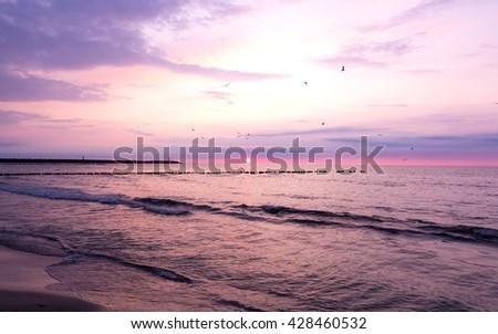 Beautiful purple sunset on the Baltic Sea, Poland - stock photo