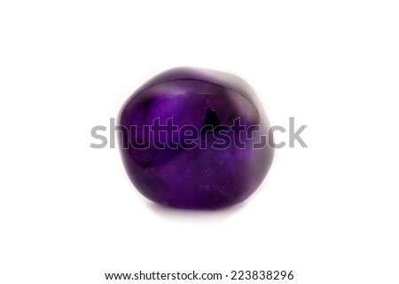 Beautiful purple/violet amethyst gemstone on a white background.