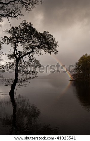 Beautiful rainbow at Derwent Water in Cumbia England - stock photo