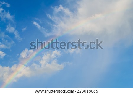 Beautiful rainbow on blue sky - stock photo
